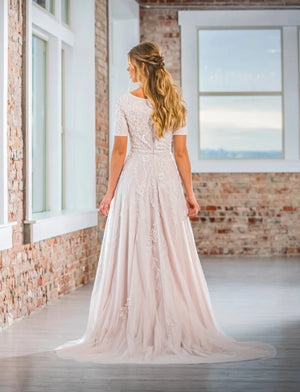 Mon Cheri TR21903 Modest Wedding Dress Back from A Closet Full of Dresses