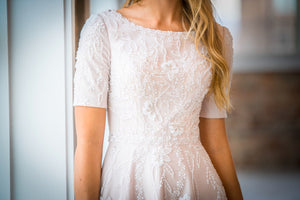 Mon Cheri TR21903 Modest Wedding Dress Close from A Closet Full of Dresses