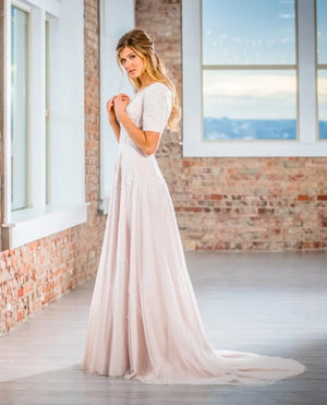 Mon Cheri TR21903 Modest Wedding Dress Side from A Closet Full of Dresses