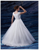 Venus Bridal TB7677 White Modest Wedding Dress back view from A Closet Full of Dresses
