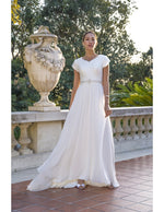 Venus Bridal TB7759 Modest Wedding Dress Front from A Closet Full of Dresses