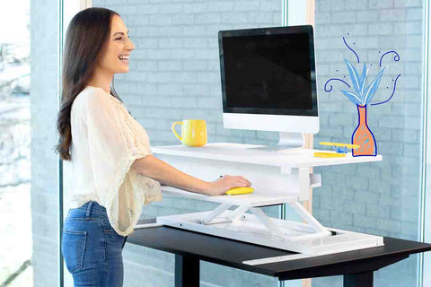 woman using her Stand Steady standing desk while working