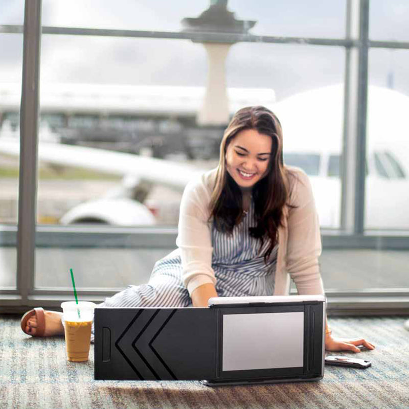 Women traveling with her SideTrak portable laptop monitor