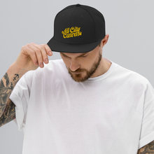 Load image into Gallery viewer, man wearing a Classic Black Snapback with a gold coloured embroidery