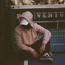 Load image into Gallery viewer, man wearing a pink hoodie