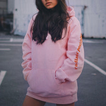 Load image into Gallery viewer, girl wearing a pink hoodie
