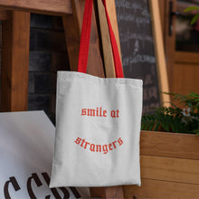 Load image into Gallery viewer, tote bag with red handles and printed design in red