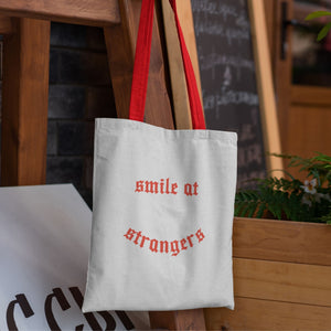 tote bag with red handles and printed design in red
