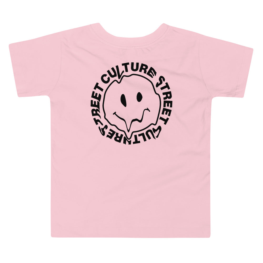 camiseta rosa con estampado de cara feliz derretida y letras BE HAPPY en color negro