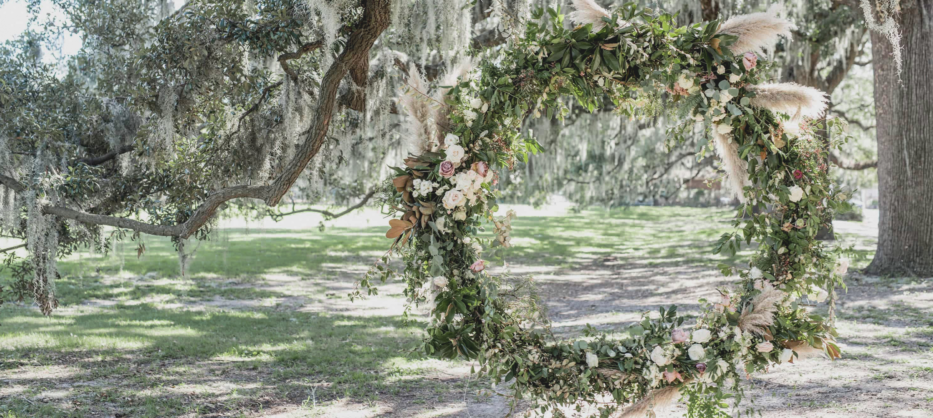 Beautiful floral hoop in the lush green grounds of a wedding venue