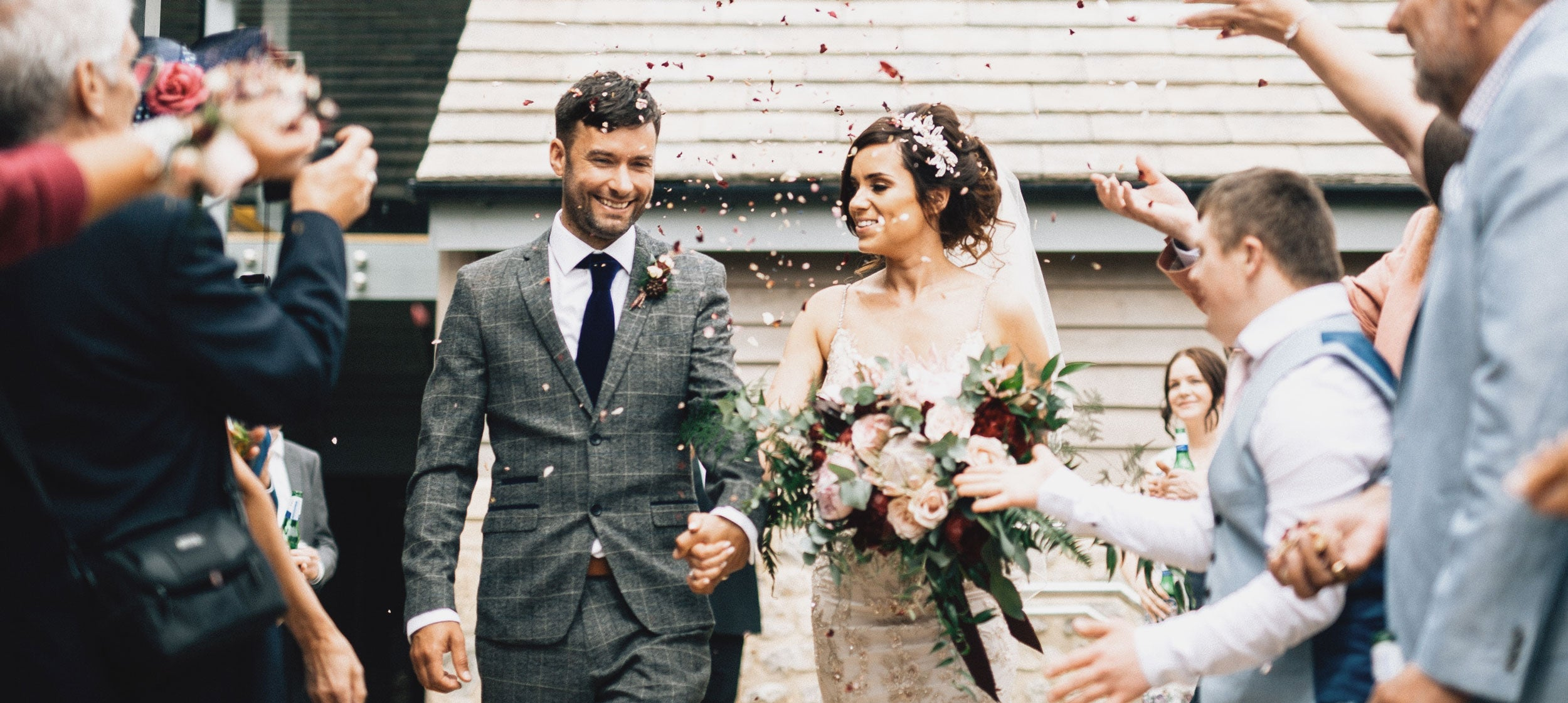 Couple get married and walk through confetti line