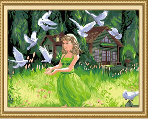 Lovely Girl with Beautiful Pigeons in the Green Fields