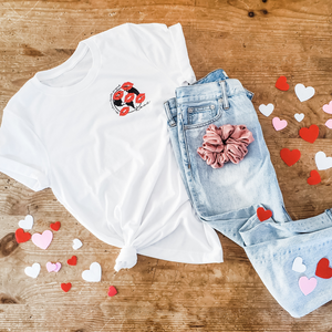 white tshirt with earth design with kisses and jeans
