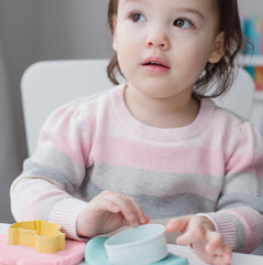little girl playing with dough