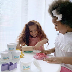 two little girls playing with dough