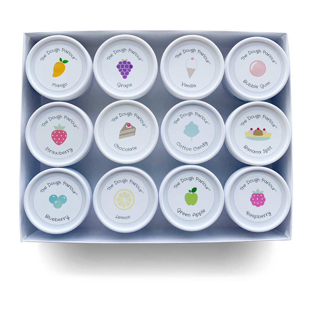 The Dough Parlour Collector's Gift box holds 12 tubs of scented dough in a white box shown on white background