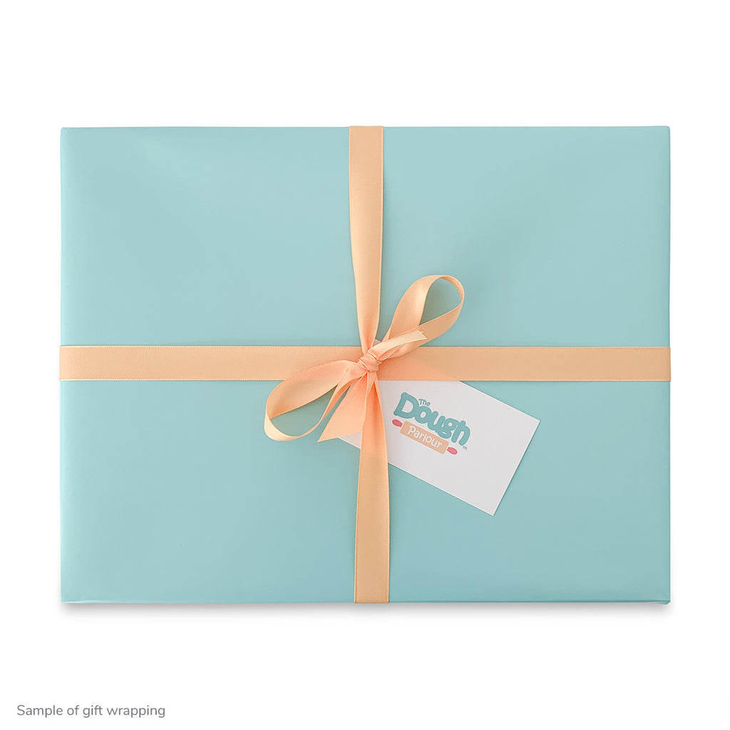 Teal wrapping paper and orange ribbon gift wrapped Collector's Gift Box shown on white background