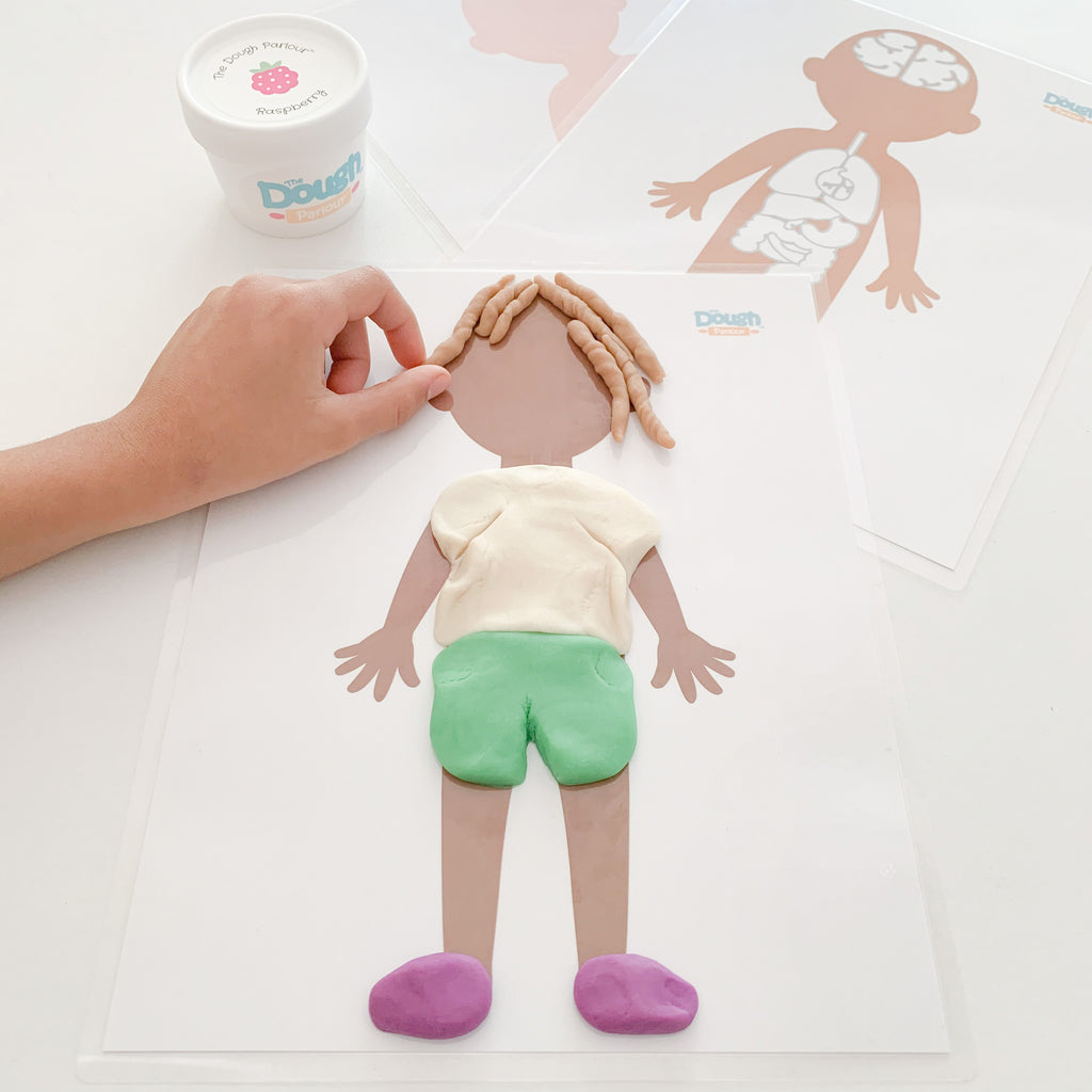 Child playing with the My Body mat with dough