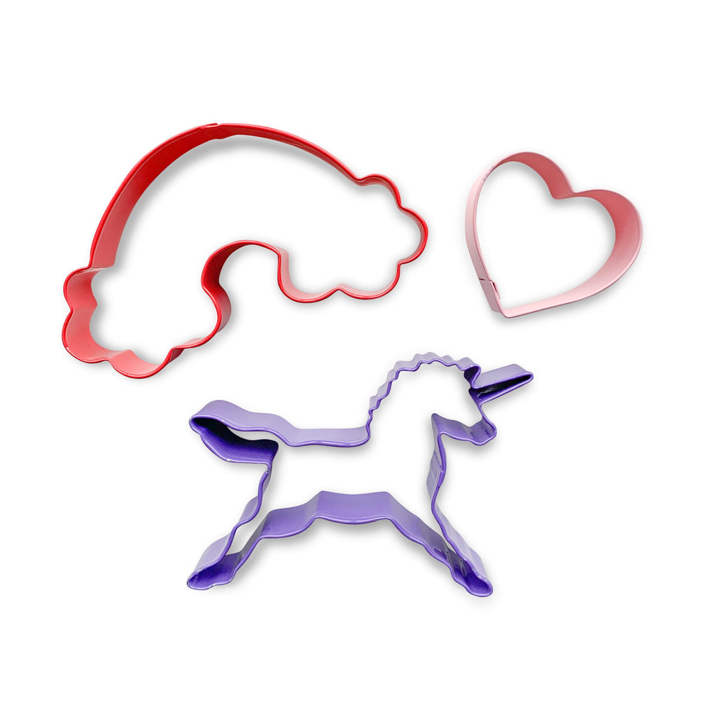 An adorable set of whimsical cutters, featuring a purple unicorn, a red rainbow and a pink heart