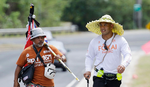 "A memorable picture of Frank Camacho and Roman Dela Cruz, where Frank ""The Crank"" Camacho takes 24-hour runwalk challenge for Guam's homeless with Roman Dela Cruz and others."