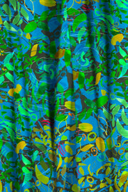 Decorative blue and green abstract pattern fabric.