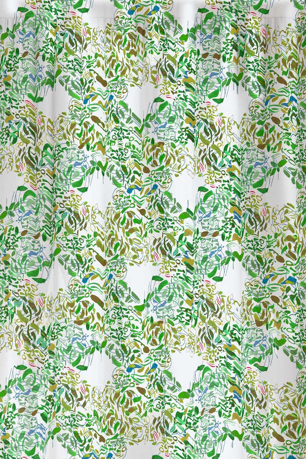 Green floral patterned fabric with imaginative design.