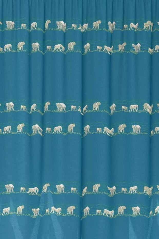 Fabric featuring a blue and yellow animal pattern design of elephants.