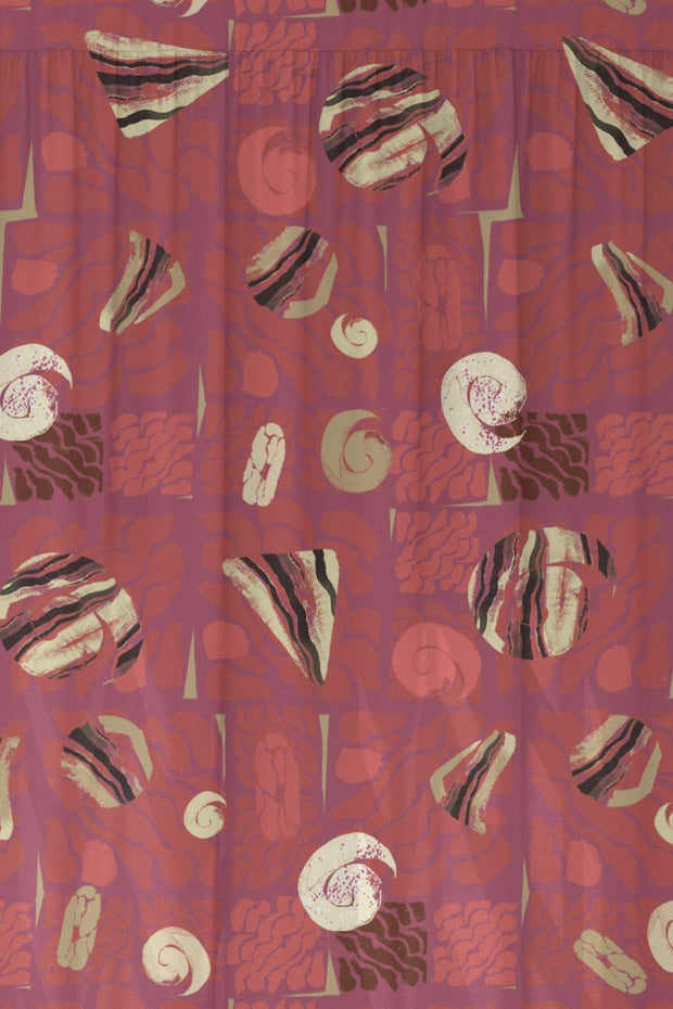Red abstract pattern fabric featuring rocky outcrops, corals and shells.