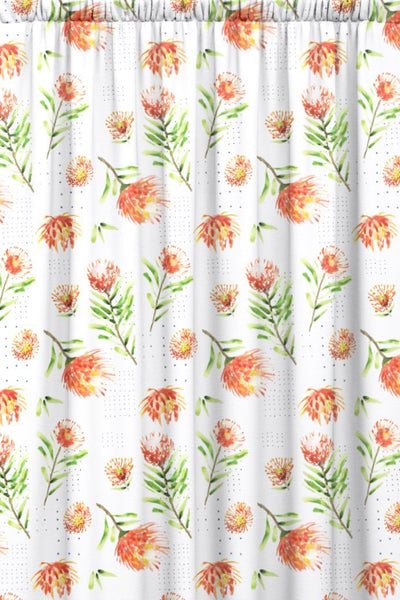 Red and white floral patterned fabric featuring red pincushion proteas on a white background.