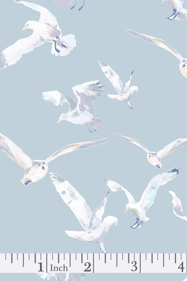 Pale blue-grey animal pattern fabric showing seagulls in flight.