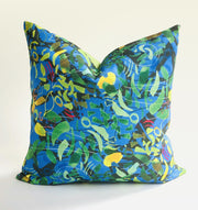 Decorative blue and green throw pillow featuring an abstract pattern design.