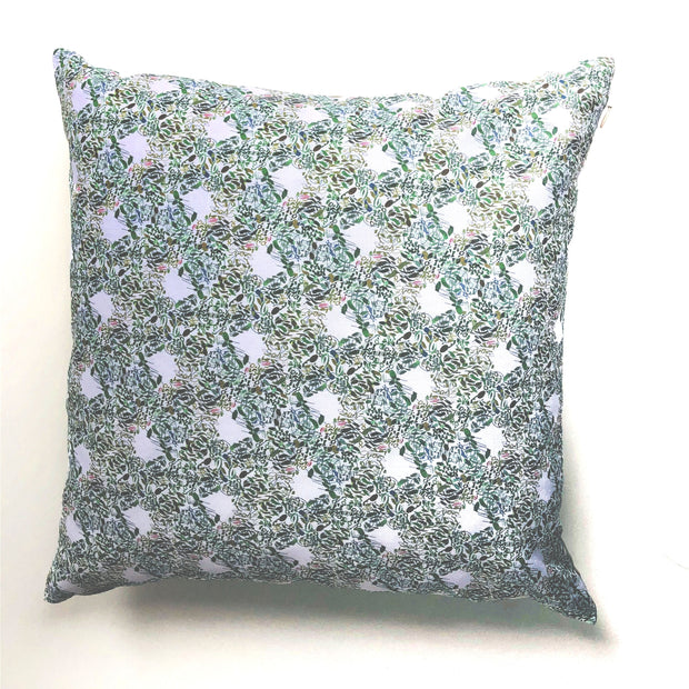Decorative green throw pillow featuring an abstract pattern design of florals and geometrics.