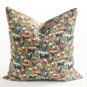Decorative yellow and blue throw pillow featuring an animal pattern design of elephant herds.