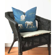 Decorative blue and yellow throw pillow featuring an animal pattern design of elephant trails.
