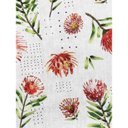 Detail of our decorative red and white throw pillow featuring our floral pattern design of pincushions.