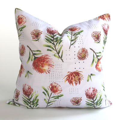 Decorative red and white throw pillow featuring our floral pattern design of pincushions.