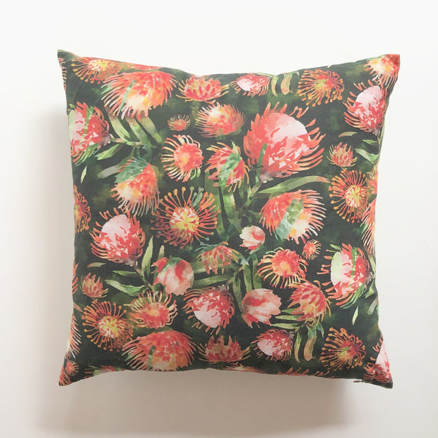 Decorative red throw pillow featuring a floral pattern design.  Edit alt text