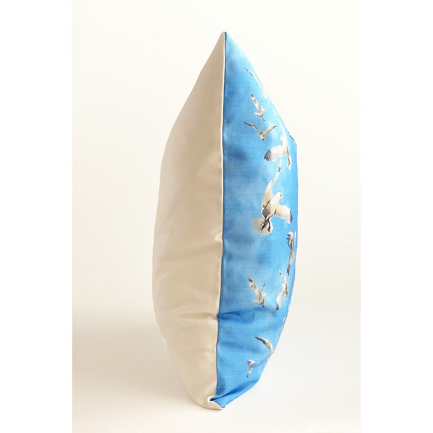 Decorative blue throw pillow featuring an animal pattern of seagulls in flight.
