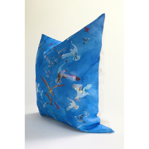 Decorative blue throw pillow featuring an abstract pattern design of birds in flight.