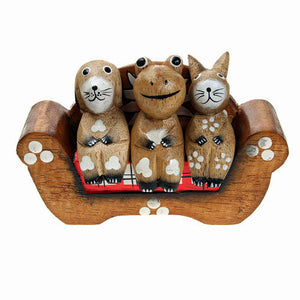A Dog, Frog and Rabbit sitting on a Sofa Ornament