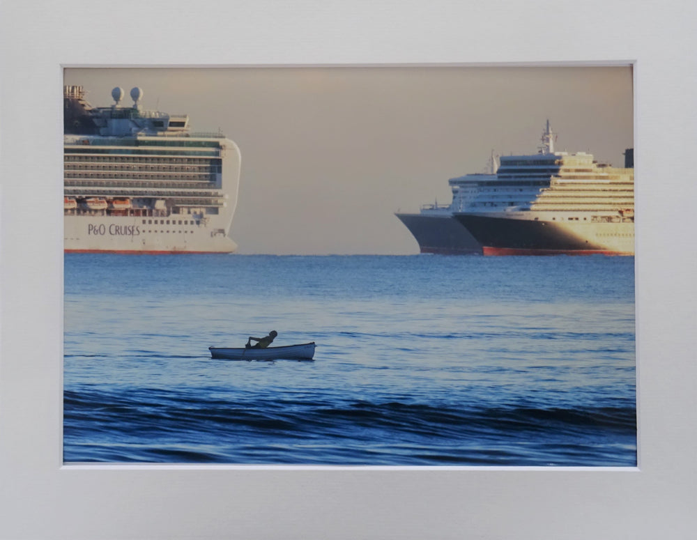 Rowing Boat with Cruise Ships