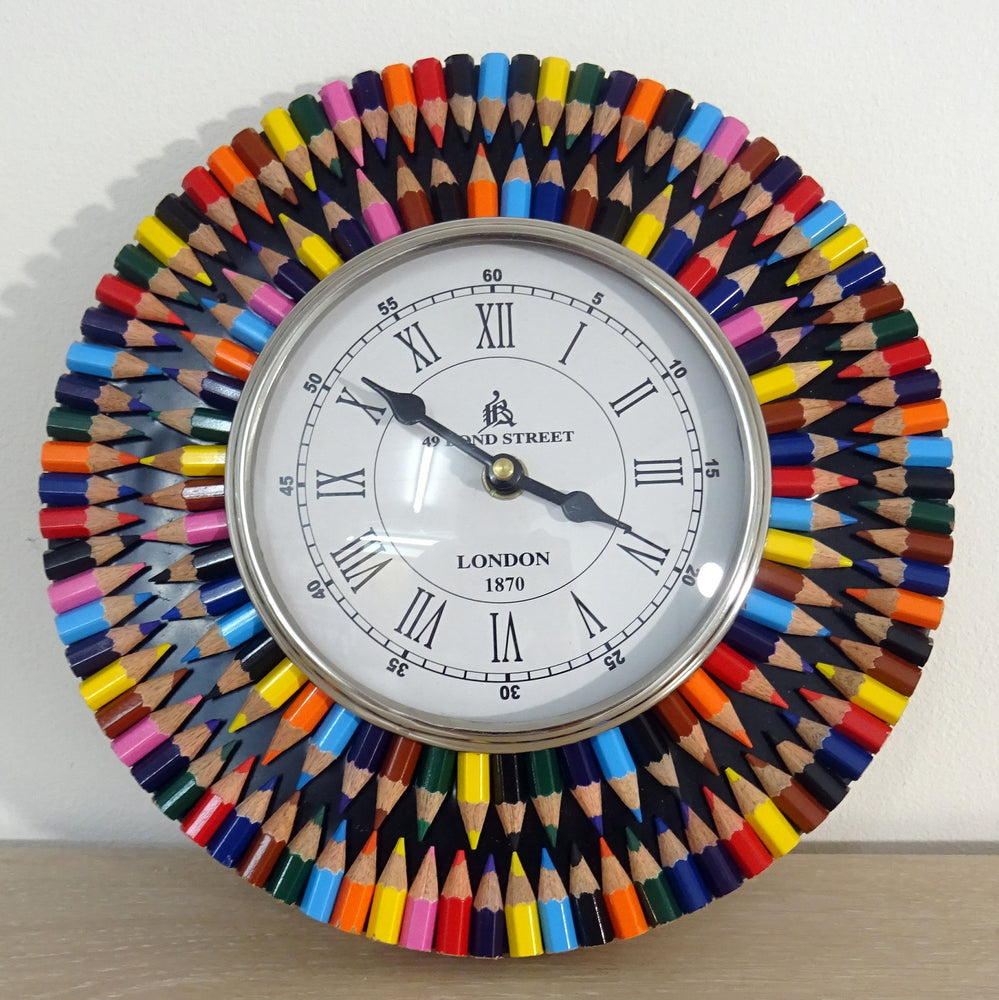 A hanging clock made from crayons