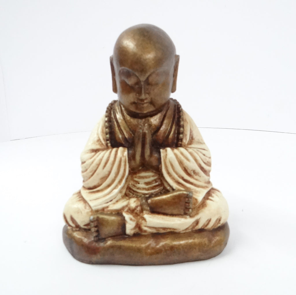 Resin Model of a Praying Buddha wearing a white cloak