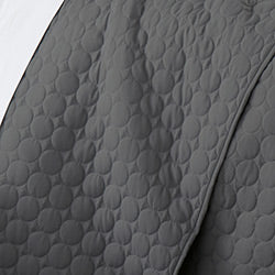closeup of modern slate circle pattern embroidered quilt set