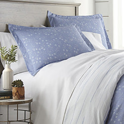 blue reversible floral and geometric print duvet and modern bedroom set
