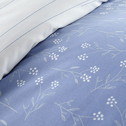 blue reversible floral and striped print duvet pattern closeup