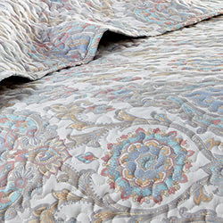 Aqua paisley printed quilt embroidered detail closeup