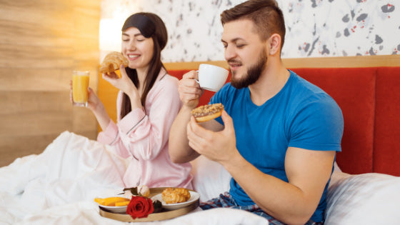 Couple having romantic breakfast in bed