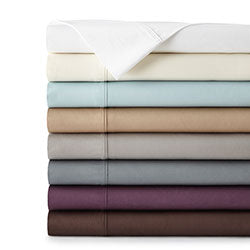 blue, brown, grey, white, offwhite, purple, teal, and taupe pillowcase set stack