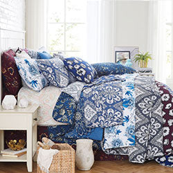 collection of printed microfiber quilts on bed